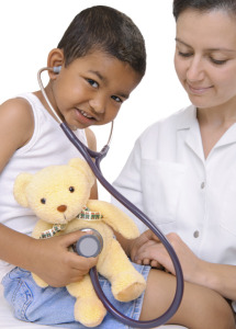 medical exam with young boy and teddy